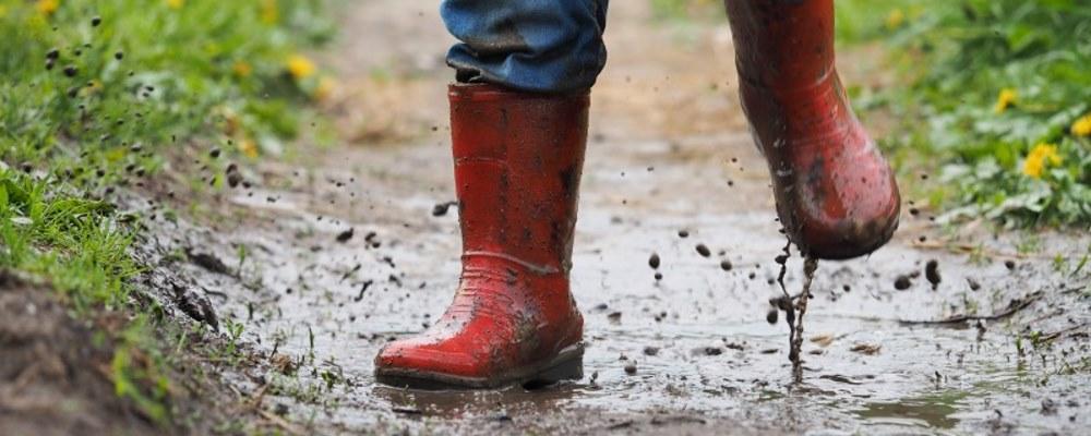 splashing in puddles in wellies