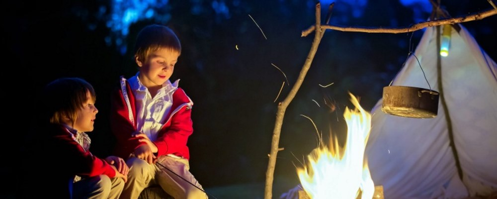 children by a campfire
